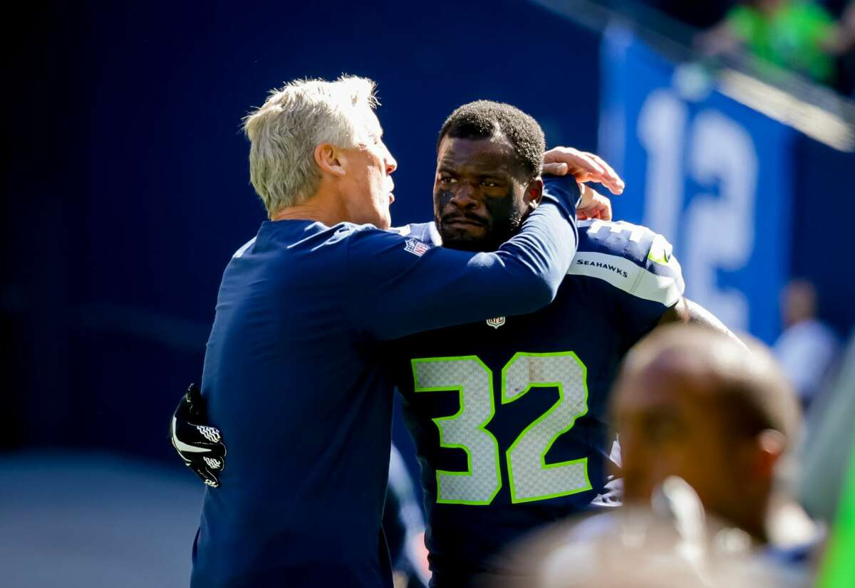 Seahawks head coach Pete Carroll hugs running back Christine Michael before the team's matchup with the San Francisco 49ers at CenturyLink Field in Seattle on September 25, 2016. The Seahawks won 37-18. (Photography by Scott Eklund/Red Box Pictures)