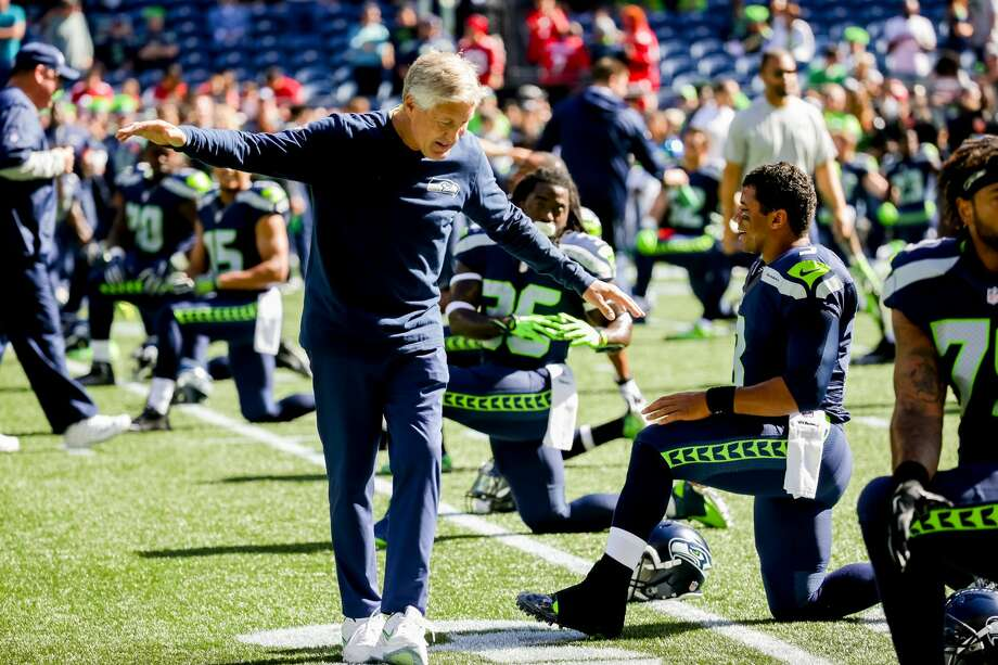 Seahawks head coach Pete Carroll and quarterback Russell Wilson speak before the team's matchup with the San Francisco 49ers at CenturyLink Field in Seattle on September 25, 2016. The Seahawks won 37-18. (Photography by Scott Eklund/Red Box Pictures) Photo: Scott Eklund/Red Box Pictures