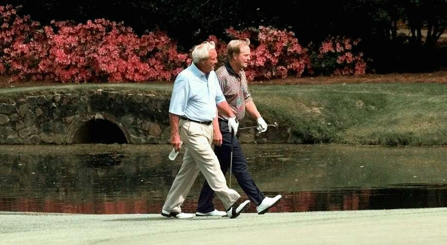 Arnold Palmer (left) and Jack Nicklaus walk on the 11th green at Augusta National in a practice round for the 1998 Masters. Photo: AMY SANCETTA, AP