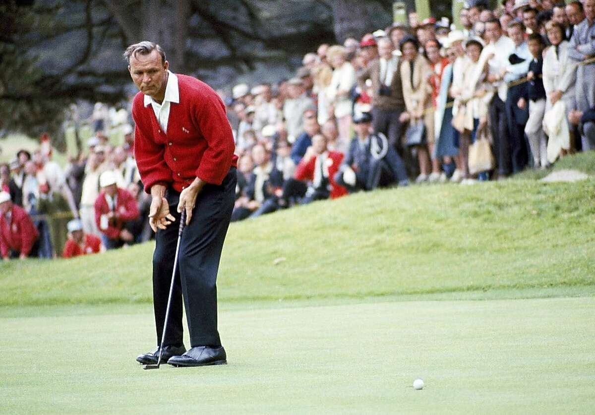 """File-This June 19, 1966, file photo shows Arnold Palmer in action during the U.S.Open Golf Championship at Olympic Country Club, San Francisco, Calif. Palmer, who made golf popular for the masses with his hard-charging style, incomparable charisma and a personal touch that made him known throughout the golf world as """"The King,"""" died Sunday, Sept. 25, 2016, in Pittsburgh. He was 87. (AP Photo, File)"""