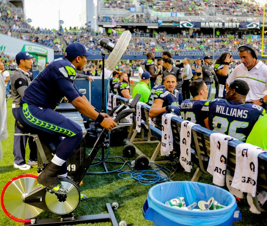 Russell Wilson stays loose after injuring his kneed during The Seattle Seahawks defeat the San Francisco 49ers 37-18 at CenturyLink  Field in Seattle on September 25, 2016. (Photography by Scott  Eklund/Red Box Pictures) Photo: Scott Eklund/Red Box Pictures