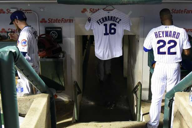 CHICAGO, IL - SEPTEMBER 25: The Chicago Cubs place a jersey in their dugout in honor of Miami Marlins Jose Fernandez who died early this morning on September 25, 2016 at Wrigley Field in Chicago, Illinois. (Photo by David Banks/Getty Images)
