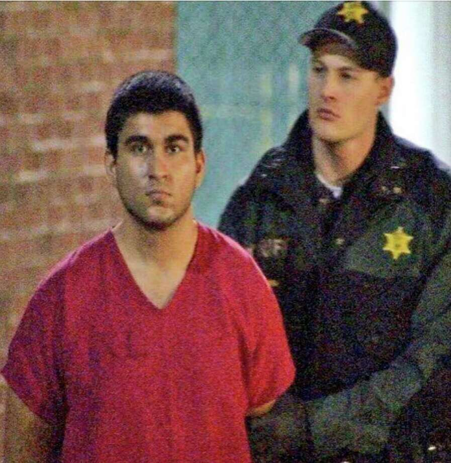 This late Saturday, Sept. 24, 2016, image from video by KIRO7 photographer Jeff Ritter shows suspected Cascade Mall shooter Arcan Cetin at Skagit County Jail in Mount Vernon, Wash., after his arrest in Oak Harbor, Wash., earlier in the evening. Investigators on Sunday tried to piece together information on the 20-year-old suspect in the deadly Washington state mall shootings who was apprehended after a nearly 24-hour manhunt. (Jeff Ritter/KIRO7.com via AP) Photo: Jeff Ritter, TEL / KIRO7.com