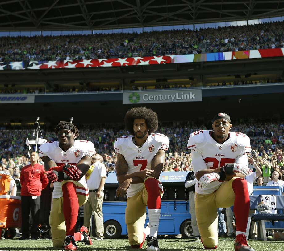 San Francisco 49ers' Eli Harold (58), Colin Kaepernick (7) and Eric Reid (35) kneel during the national anthem before an NFL football game against the Seattle Seahawks at CenturyLink Field, Sunday, Sept. 25, 2016, in Seattle. (AP Photo/Ted S. Warren) Photo: Ted S. Warren, Associated Press
