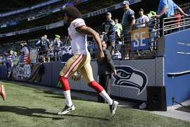 San Francisco 49ers quarterback Colin Kaepernick runs onto the field for warmups before an NFL football game against the Seattle Seahawks, Sunday, Sept. 25, 2016, in Seattle. (AP Photo/Ted S. Warren)