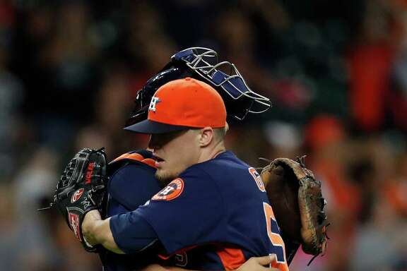 Astros closer Ken Giles, right, gets a congratulatory hug from catcher Jason Castro after recording the final out in Sunday's 4-1 victory over the Angels at Minute Maid Park.