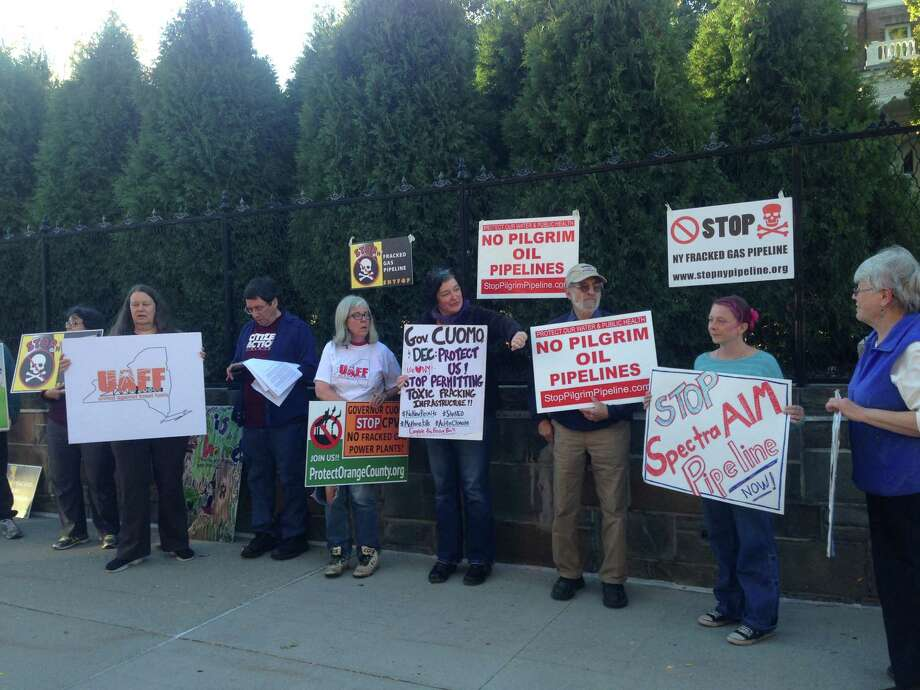 Protesters objecting to the Spectra AIM gas pipeline outside the Governor's Mansion Sunday evening (photo by Amy Biancolli)