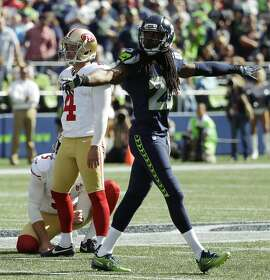 Seattle Seahawks cornerback Richard Sherman (25) signals no-good after San Francisco 49ers kicker Phil Dawson (4) missed a field goal attempt in the first half of an NFL football game, Sunday, Sept. 25, 2016, in Seattle. (AP Photo/Ted S. Warren)