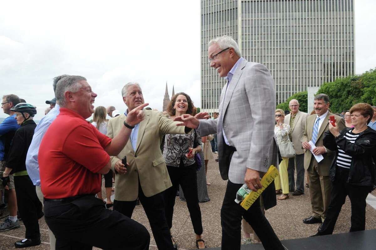Joseph Nicolla, president of Columbia Development, center, jokes with Assemblymember John McDonald, left, and former Albany Mayor Jerry Jennings before the Wellington Annex is imploded to make way for the new Capital Center on Saturday Aug. 23, 2014 in Albany, N.Y. (Michael P. Farrell/Times Union)