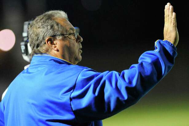 Bishop Maginn head coach Joe Grasso instructs his players against Troy during the first half of their Section II Class A football game on Friday, Oct. 3, 2014, in Albany, N.Y., (Hans Pennink / Special to the Times Union) ORG XMIT: HP108