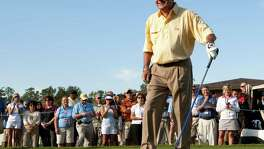 Arnold Palmer walks off the tee box during the Championship Pro-Am at the Administaff Small Business Classic at The Woodlands Country Club in 2010.