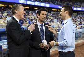 In this Monday, Sept. 19, 2016 photo Dodgers broadcasters, from left, Orel Hershiser, Nomar Garciaparra and Joe Davis chat prior to a baseball game between the Los Angeles Dodgers and the San Francisco Giants, in Los Angeles. As Vin Scully closes out his Hall of Fame career calling Los Angeles Dodgers games, his successor is waiting in the wings. Joe Davis has been working road games for the team this season, warming up for next year when the 28-year-old will move into Scully's old booth full-time. (AP Photo/Mark J. Terrill)