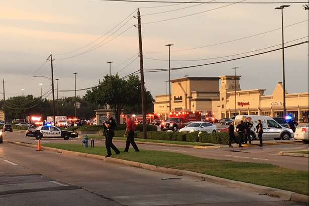Multiple law enforcement officers are seen near a strip mall where a gunman fired shots at passersby in southwest Houston, Texas on Sept. 26, 2016. Several people were injured as a result.