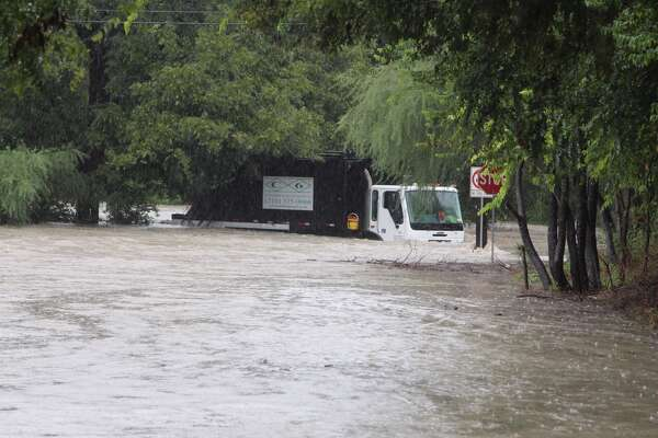 Emergency personnel rescued a garbage truck driver after large amounts of rain flooded San Antonio streets on the Northeast Side.