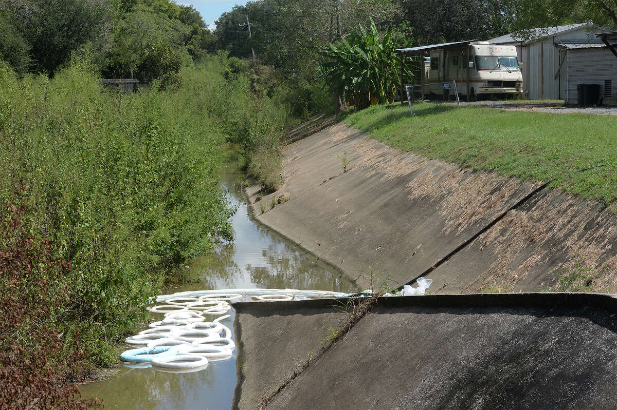 Several spill booms can be seen in the Willow Marsh Bayou near East Lane on Friday. A clean up and and shelter in place was ordered for the area after a solvent spill into the water at General Electric: Betz Water and Process Technologies facility in Beaumont. Photo taken Friday, September 23, 2016 Guiseppe Barranco/The Enterprise
