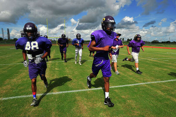 Sabine Pass' varsity football team gets in a final practice Thursday before facing Hardin. The Sharks were 3-0 heading into Friday night's game, a statistic that brings pride to the program which has steadily rebuilt after Hurricanes Rita and then Ike devastated the team as well as the town. Photo taken Thursday, September 22, 2016 Kim Brent/The Enterprise