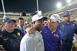 Advocate staff photo by TRAVIS SPRADLING -- LSU head coach Les Miles puts his arm around running backs coach Frank Wilson, left, as they head to the tunnel after the LSU-Texas A&M football game in Baton Rouge, Saturday, Nov. 28, 2015. LSU won, 19-7, and LSU running back Leonard Fournette (7) broke the team single season rushing record that night.
