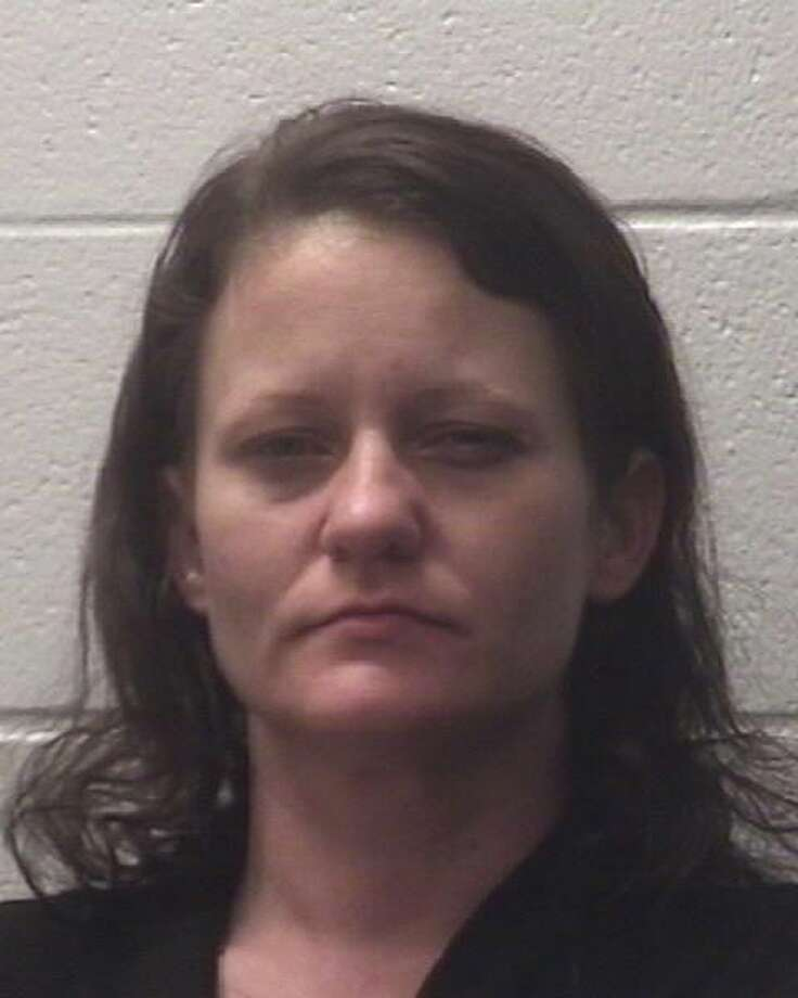 Amanda Dixon, 37, of Pasadena, was arrested Sunday, Sept. 25, 2016 by Deer Park police. She and two others are accused of stealing mail and creating fraudulent identification and checking accounts to fund their methamphetamine use, police said. Photo: Deer Park Police Department
