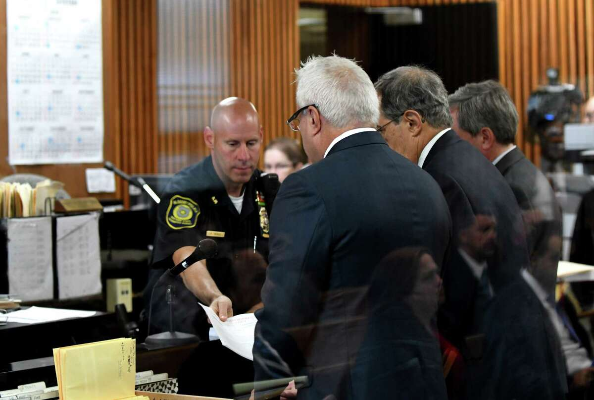 Prominent Albany developer Joseph Nicolla, left, is handed papers during his arraignment on state charges for alleged bid-rigging on Monday morning, Sept. 26, 2016, at Albany City Courthouse in Albany, N.Y. Nicolla is the President of Columbia Development. (Will Waldron/Times Union)