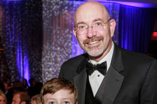 Honoree Dr. Mike Feinberg and his son, Gus, at the Big Brothers Big Sisters gala.  (For the Chronicle/Gary Fountain, September 23, 2016)