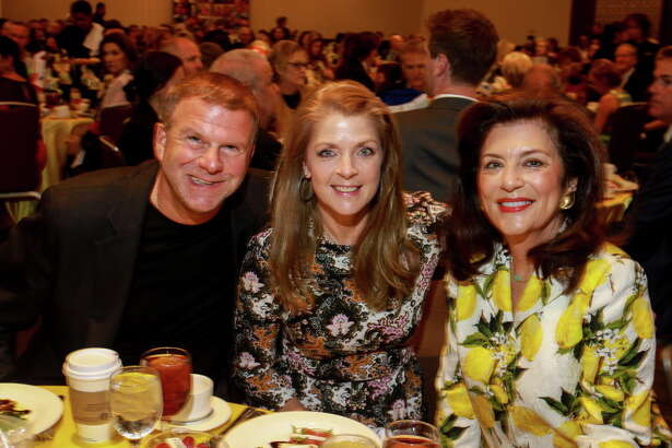 """Tilman and Paige Fertitta, from left, with Dancie Ware at """"Two Decades of Caring,"""" Houston Children Charity's 20th anniversary luncheon. (For the Chronicle/Gary Fountain, September 23, 2016)"""