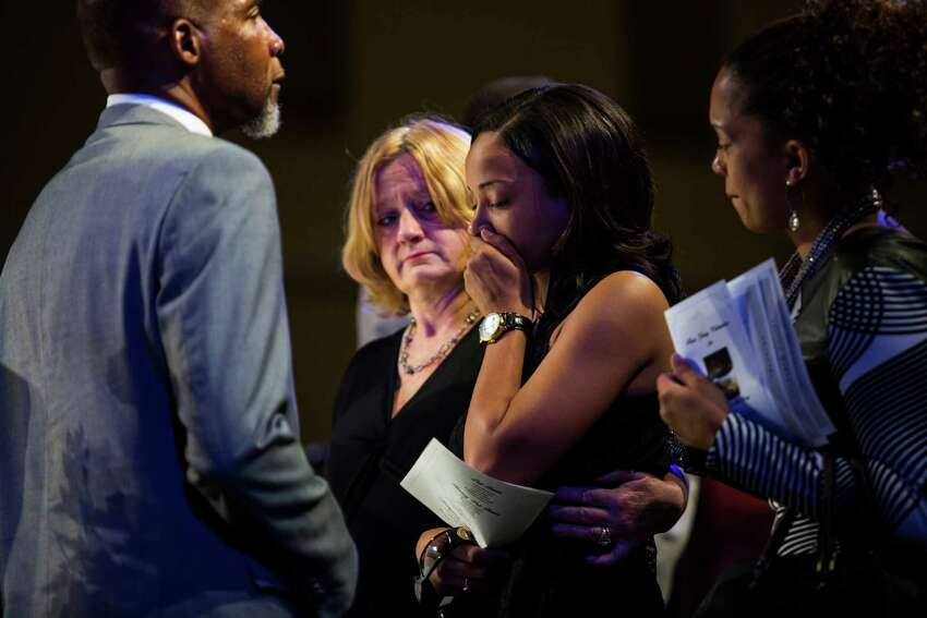 Wanika Wade, the widow of Melvin Mckinney, sobs as she views her husband's casket during his funeral at True Vision Church on August 2, 2016. McKinney was the last of four prisoners who committed suicide in the Bexar County Jail.