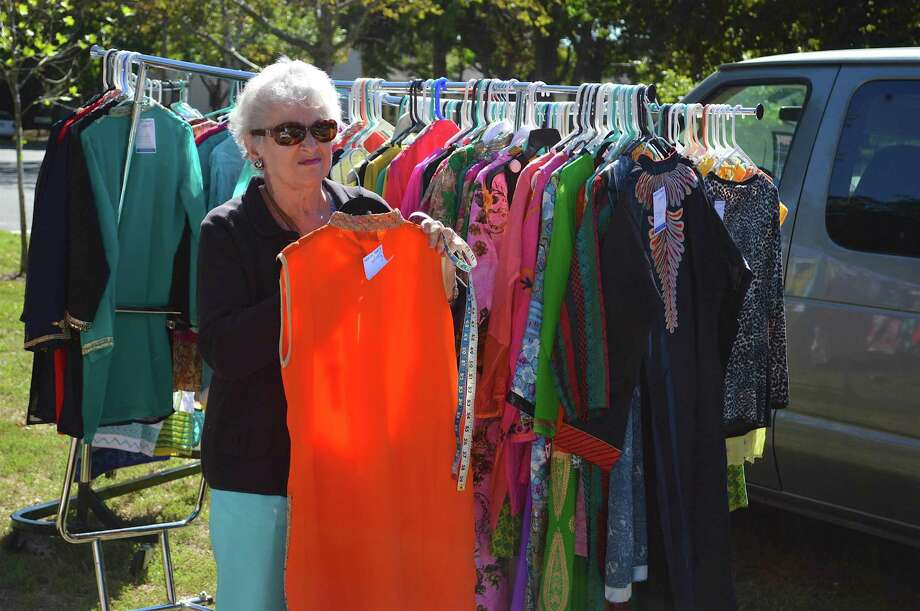 Anglea McKeon of Fairfield examines some imported outfits at the 10th annual Heritage India Festival at Town Hall Green, Sunday, Sept. 25, 2016, in Fairfield, Conn. Photo: Jarret Liotta / For Hearst Connecticut Media / Fairfield Citizen News Freelance