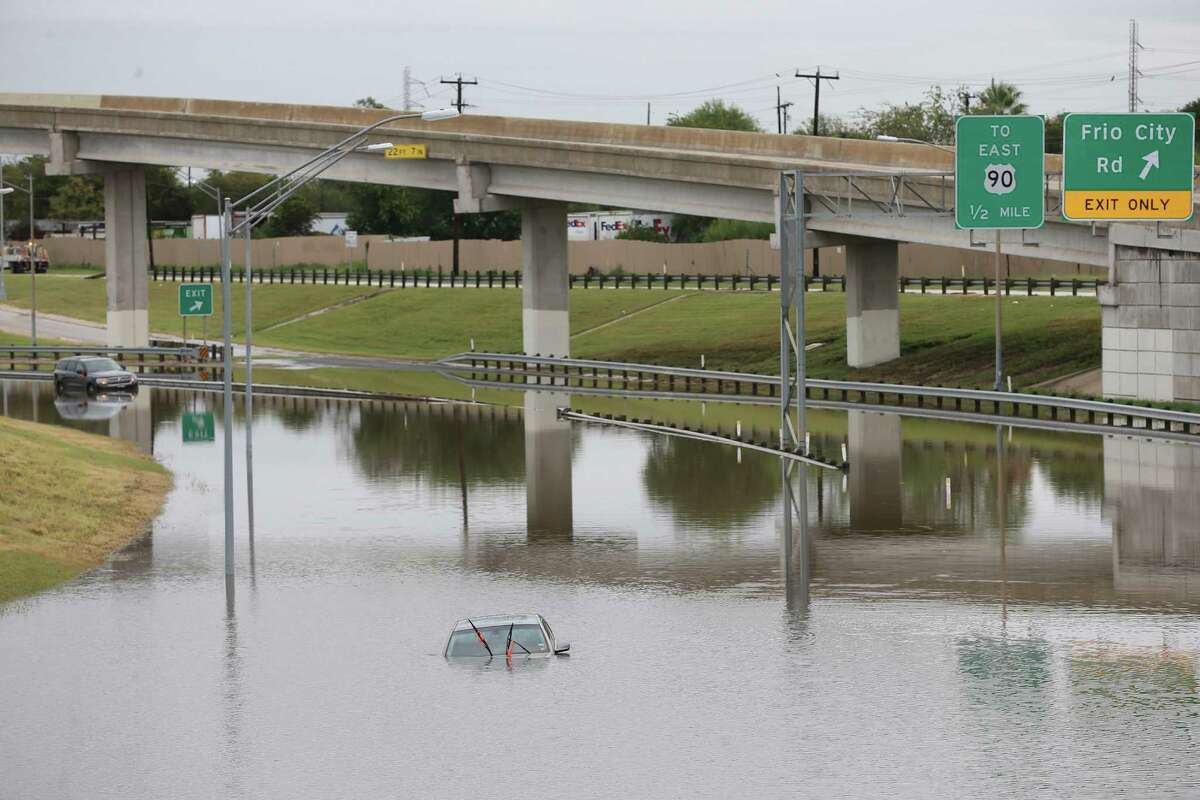 Vehicles are left stranded in high water along General Hudnell Drive east of Port San Antonio after heavy rains cause flooding throughout San Antonio, Monday, Sept. 26, 2016. The San Antonio Fire Department responded to over 40 water rescues throughout the morning.
