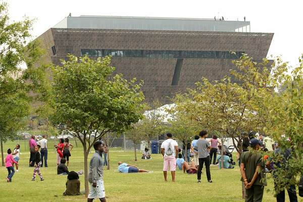 WASHINGTON, DC - SEPTEMBER 24:  People gather early to attend the opening of the Smithsonian National Museum of African American History & Culture on September 24, 2016 in Washington, DC.  (Photo by Paul Morigi/Getty Images)