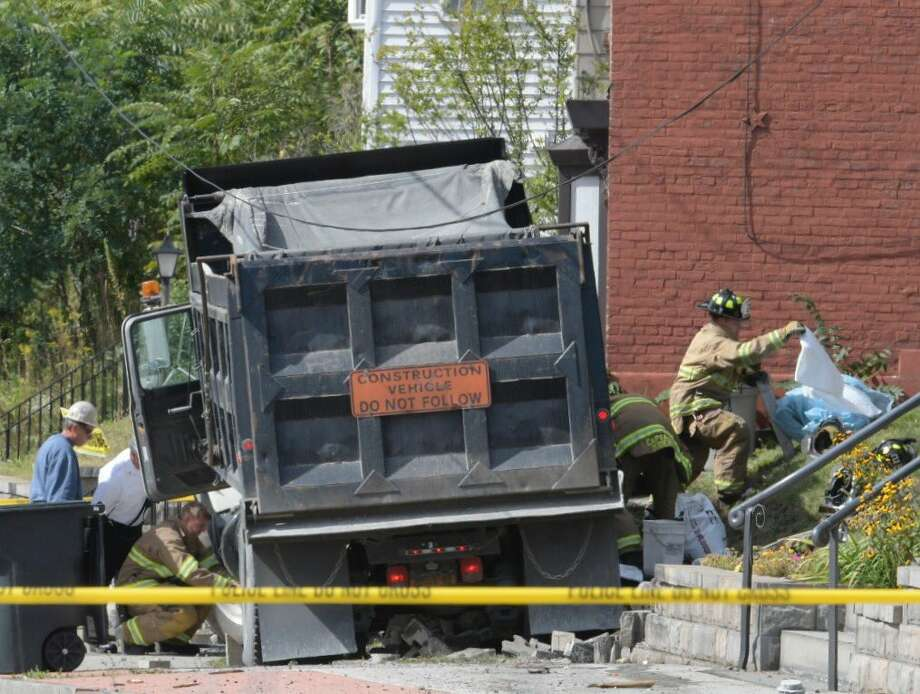 This is the scene on Congress Street, Trot, after a dump truck collided with a utility pole. (Skip Dickstein / Times Union)