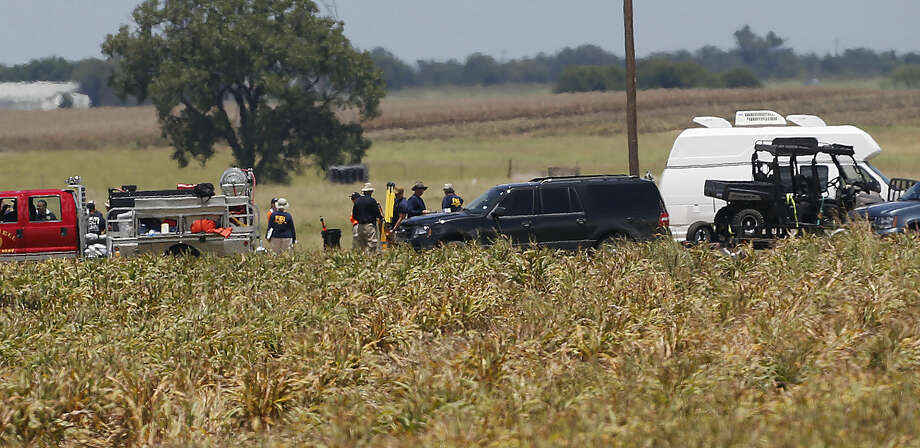 First responders and investigators appear at a scene of a balloon crash that reports indicate took the lives of 16 people near Maxwell, Texas in Caldwell County Saturday, July 30, 2016. (Kin Man Hui/The San Antonio Express-News via AP) Photo: Kin Man Hui