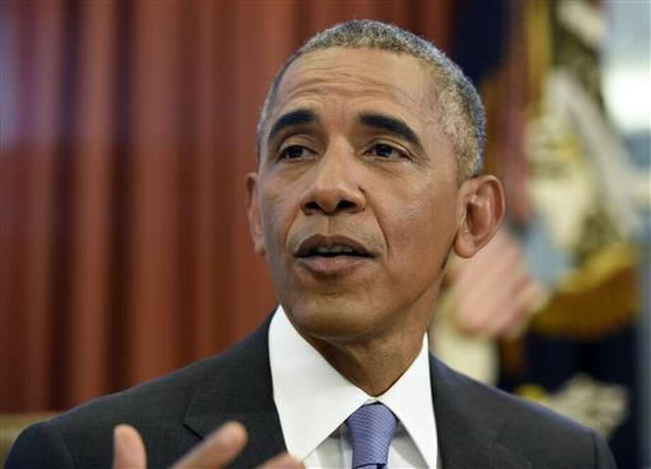 President Barack Obama talks before signing the FOIA Improvement Act of 2016 and the Puerto Rico Oversight, Management, and Economic Stability Act in the Oval Office of the White House in Washington, Thursday, June 30, 2016. (AP Photo/Susan Walsh)