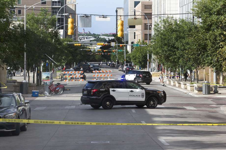 Police tape off areas on East 6th Street in Austin, Texas where a woman was fatally shot on Sunday, July 31, 2016. A shooter opened fire on a crowd at about 2 a.m. Sunday morning. (Jessalyn Tamez/Austin American-Statesman/TNS)less Photo: Photo: Jessalyn Tamez, TNS
