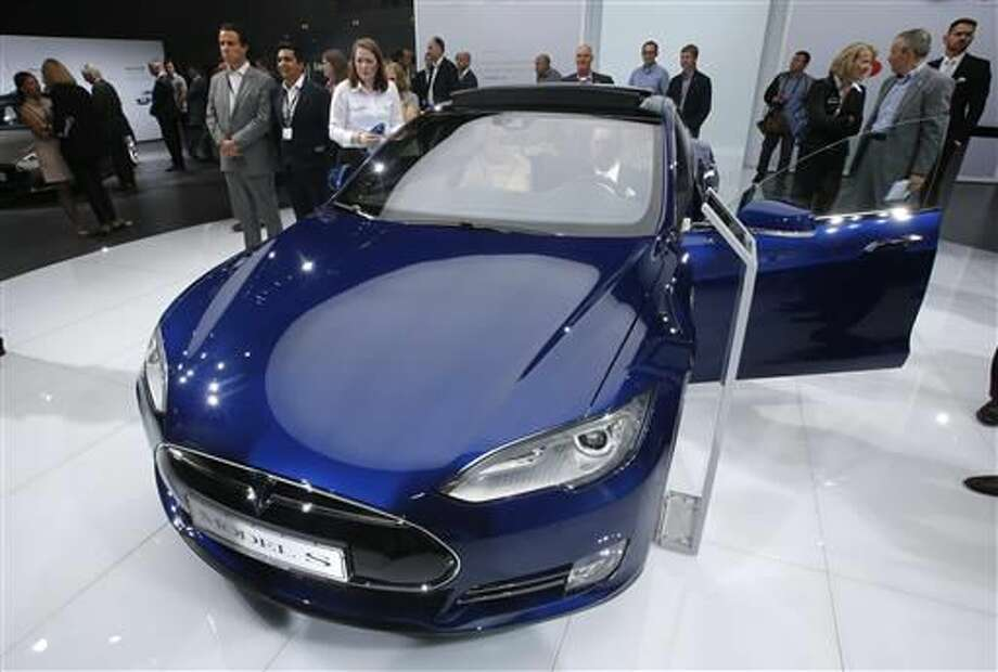 """FILE - In this Sept. 15, 2015 file photo, a Tesla Model S is on display on the first press day of the Frankfurt Auto Show IAA in Frankfurt, Germany. Federal officials say the driver of a Tesla S sports car using the vehicle's """"autopilot"""" automated driving system has been killed in a collision with a truck, the first U.S. self-driving car fatality. The National Highway Traffic Safety Administration said preliminary reports indicate the crash occurred when a tractor-trailer made a left turn in front of the Tesla at a highway intersection. NHTSA said the Tesla driver died due to injuries sustained in the crash, which took place on May 7, 2016 in Williston, Fla. (AP Photo/Michael Probst, File)"""