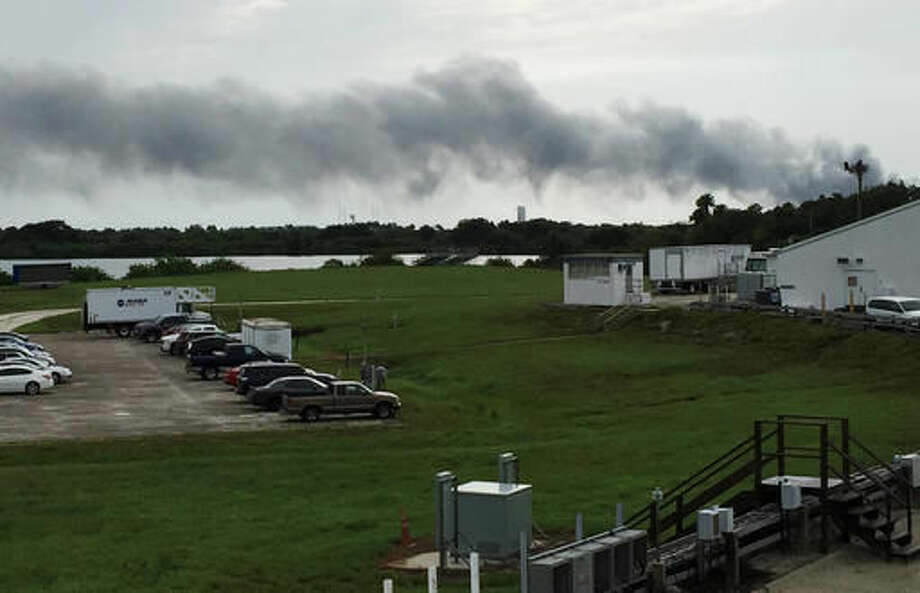 Smoke rises from a SpaceX launch site Thursday, Sept. 1, 2016, at Cape Canaveral, Fla. NASA said SpaceX was conducting a test firing of its unmanned rocket when a blast occurred. (AP Photo/Marcia Dunn) Photo: Marcia Dunn