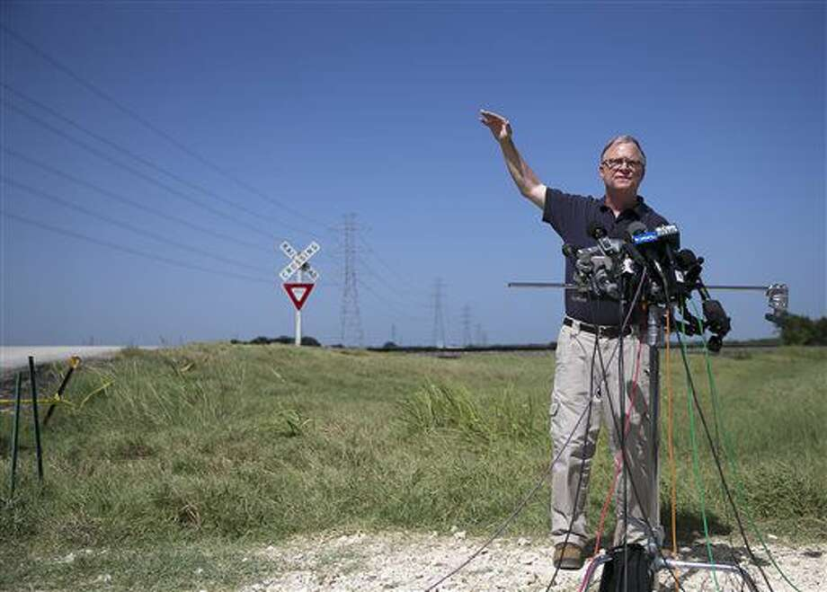 National Transportation Safety Board (NTSB) member Robert Sumwalt talks about power lines, left, during a news conference at the scene of Saturday's hot air balloon crash near Lockhart, Texas, Monday, Aug. 1, 2016. The balloon made contact with the wires. Sixteen people were killed in the crash. (Deborah Cannon/Austin American-Statesman via AP) Photo: Deborah Cannon