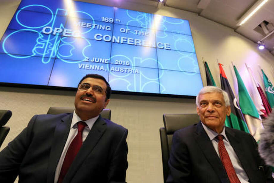 Mohammed Bin Saleh Al-Sada, Minister of Energy and Industry of Qatar and President of the OPEC Conference, and OPEC's Secretary General Abdalla Salem El-Badri, from Libya, from left, speaks to journalists before the start of a meeting of the Organization of the Petroleum Exporting Countries today at their headquarters in Vienna, Austria. Photo: Associated Press