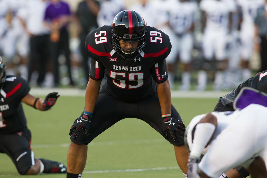 Talor Nunez, a Lee grad, is seen here blocking during an extra point attempt for Texas Tech during a game in 2014. Photo: Norvelle Kennedy