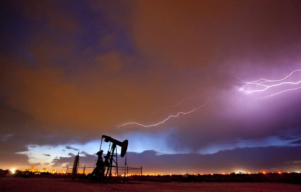 Lightning strikes over a pumpjack near Fairgrounds Road in Midland, Saturday, May 7, 2016. James Durbin/Reporter-Telegram