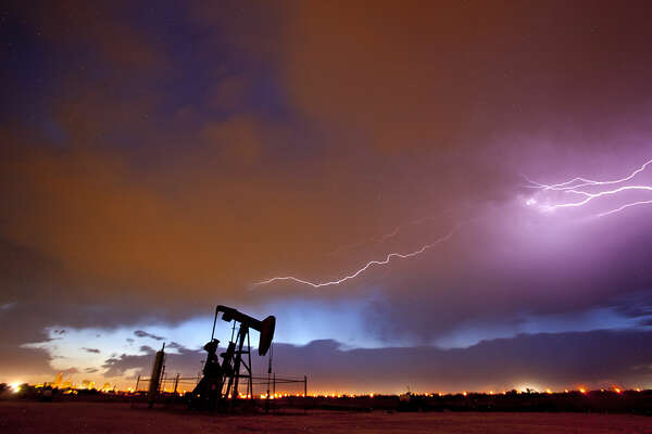 Lightning strikes over a pumpjack near Fairgrounds Road in Midland, Saturday, May 7, 2016. James Durbin/Reporter-Telegram