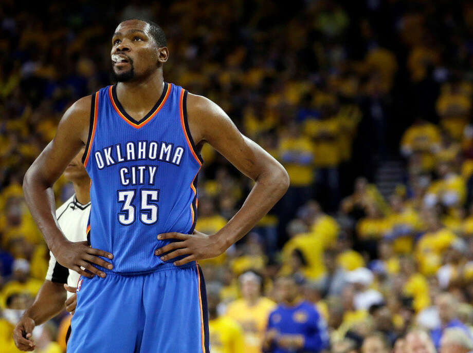 In this May 26, 2016, file photo, Oklahoma City Thunder's Kevin Durant watches during the closing minutes of the second half in Game 5 of the NBA basketball Western Conference finals against the Golden State Warriors in Oakland, Calif. (AP Photo/Marcio Jose Sanchez) Photo: Marcio Jose Sanchez/AP Photo