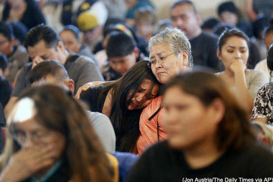 This Tuesday, May 3, 2016 photo community members comfort one another, during a vigil for Ashlynne Mike at the San Juan Chapter House in Lower Fruitland, N.M. (Jon Austria/The Daily Times via AP) Photo: Jon Austria