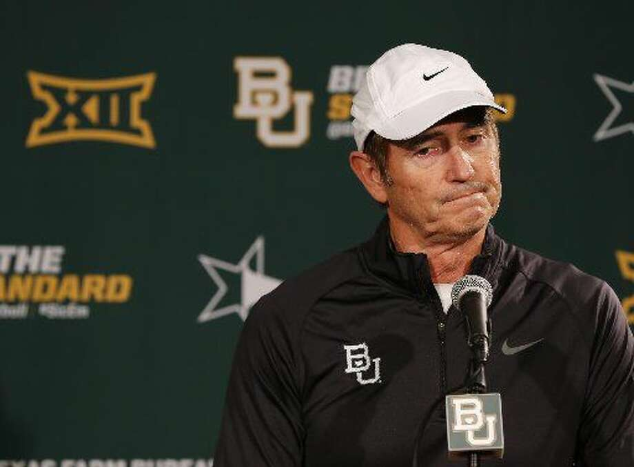 Baylor NCAA college head football coachArtBrilesresponds to questions during a press conference Sunday, Dec. 7, 2014, in Waco, Texas. After weeks of talk about whether Baylor or TCU deserved to be in the playoff, neither made it Sunday, and the Big 12 may be reconsidering how to declare its champion. (AP Photo/Waco Tribune Herald, Rod Aydelotte)