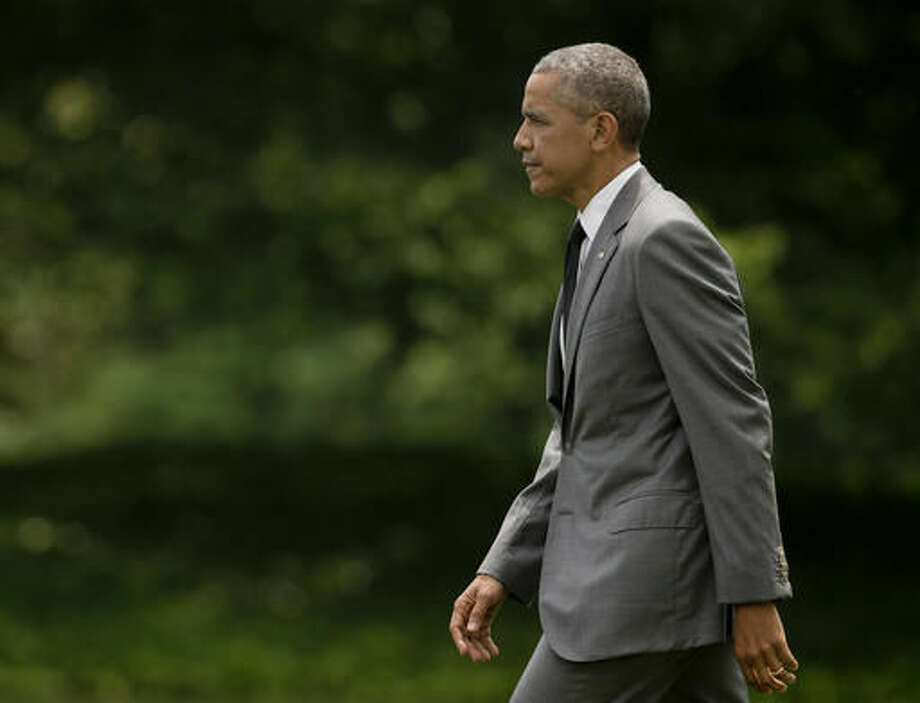 President Barack Obama walks across the South Lawn of the White House in Washington, Friday, June 3, 2016, before boarding the Marine One helicopter for the short ride to nearby Andrews Air Force Base, Md. Obama is traveling to Miami for a pair of Democratic fundraisers.(AP Photo/Pablo Martinez Monsivais) Photo: Pablo Martinez Monsivais