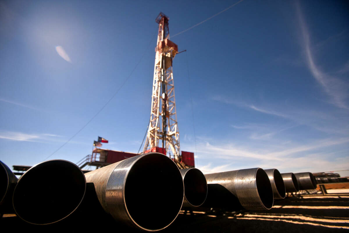 Pipe casing stacked up beside Robinson Drilling rig #4 on Wednesday, Feb. 17, 2016, in Midland County. James Durbin/Reporter-Telegram