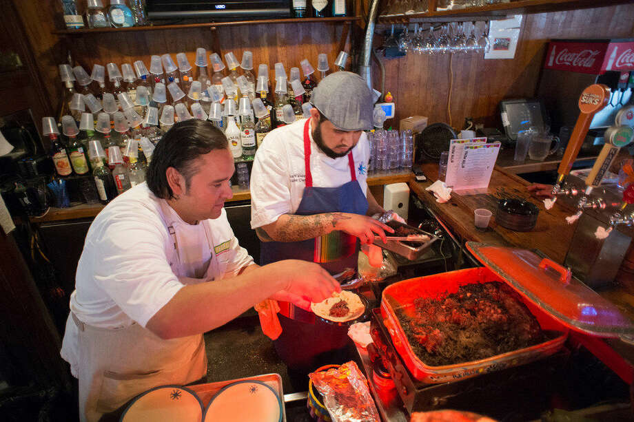 Chef Johnny Hernandez and his Research and Development Chef Luciano Valadez make up their barbacoa and Lengua breakfast tacos for the judges at the Breakfast Taco Battle at Casa San Antonio based in Old School bar and Grill Friday for South by Southwest. Photo: Josh Bachman /For The Express-News