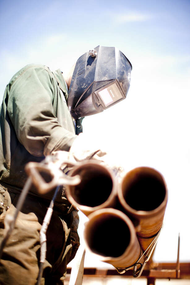 Luis Franco moves pipe at C and R Pipe Inspection on E. Taylor Ave. as the temperature peaked at 107 degrees according to the National Weather Service, Tuesday, July 5, 2016. James Durbin/Reporter-Telegram Photo: James Durbin