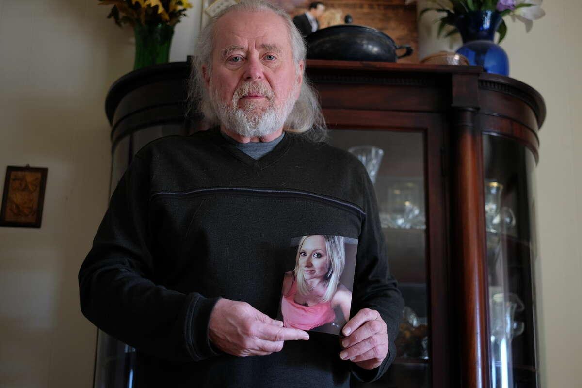 Former Odessa Police Department officer Jon Nielsen holds a photo of his daughter, Monica Deming, who died Nov. 29. She was shot and killed ber her ex-boyfried, Brandon Leyva.