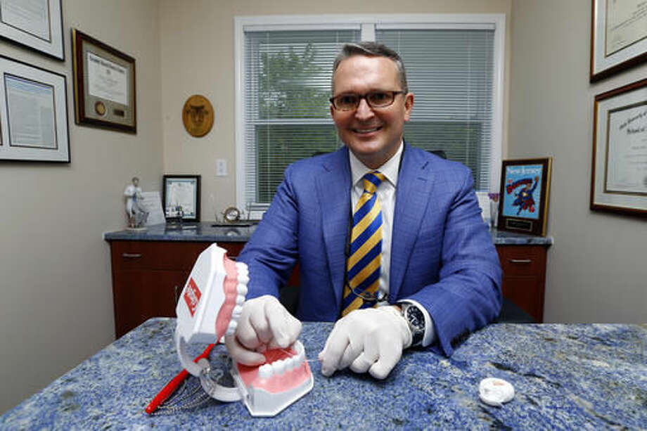 Dr. Wayne Aldredge, president of the American Academy of Periodontology, sits for a photo at his office in Holmdel, N.J. Aldredge acknowledges the weak scientific evidence and the brief duration of many studies on flossing, but says that the impact of floss might be clearer if researchers focused on patients at the highest risk of gum disease, such as diabetics and smokers. (AP Photo/Julio Cortez) Photo: Julio Cortez