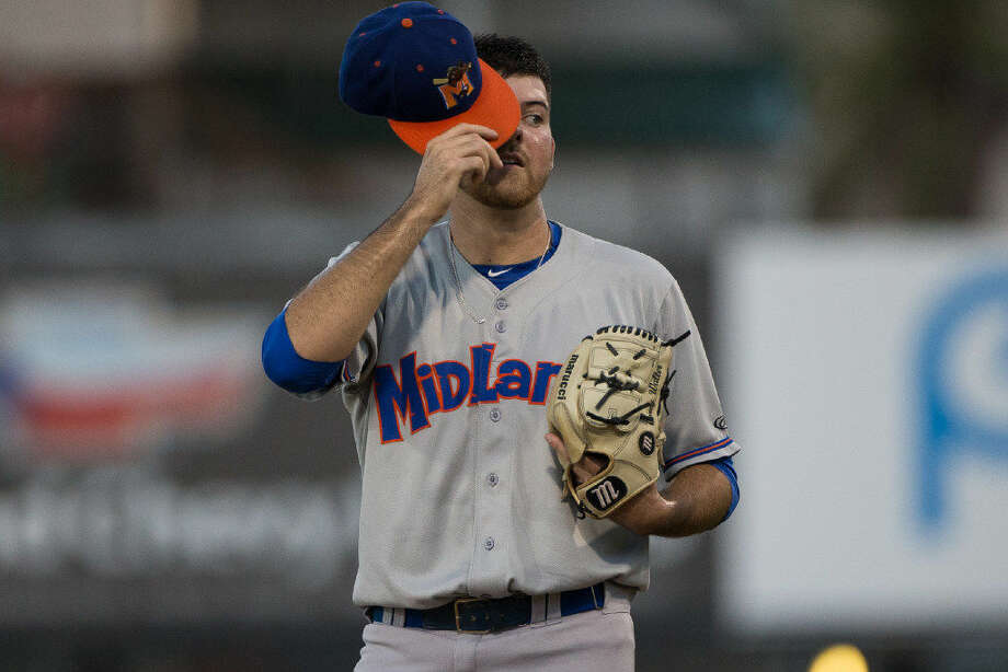 Midland Rockhounds pitcher Corey Walter wipes sweat from his forehead with a full count during the second inning of their game against the Hooks at Whataburger field on Thursday, Sept. 8, 2016. Photo by Courtney Sacco | Corpus Christi Caller-Times Photo: Courtney Sacco | Corpus Christi Caller-Times
